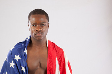 Shirtless black man with American flag
