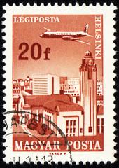Flying plane above the Helsinki on post stamp