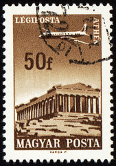 Flying plane above the Athens on post stamp
