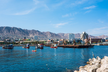 Colourful wooden fishing boats in the harbour at Antofagasta in