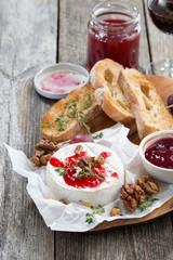 delicious appetizers for wine - camembert with berry jam, toast