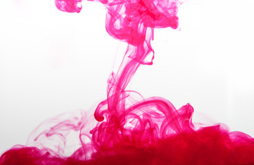 pink ink spread in water