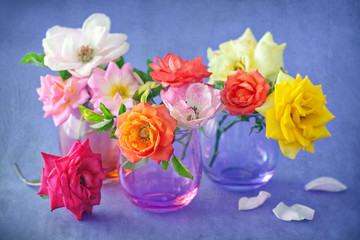 Floral composition with a roses on a table.