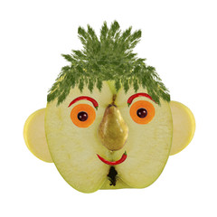 Creative food concept. Funny portrait made of  apples, vegetable