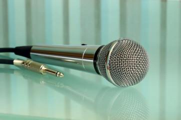Metallic microphone taken closeup.