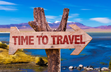 Time to Travel direction sign with landscape background