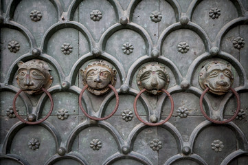 Lion Heads Cathedral Door Venice Italy