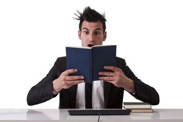 surprised businessman reading