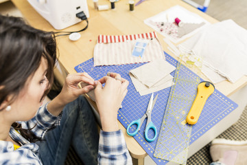 Young girl making hand bags and accessories at home