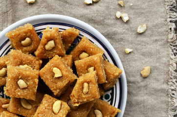 Homemade burfi - indian sweets with chickpea flour, cardamom and