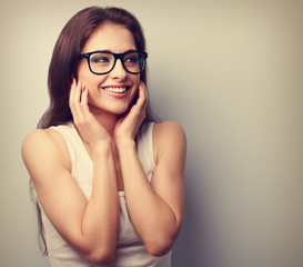 Happy laughing young casual woman holding hands the face. Vintag