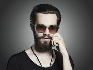 fashionable handsome man. Brutal bearded boy in sunglasses