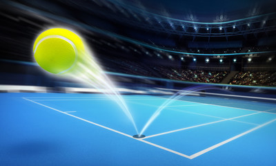 flying tennis ball on a blue court in motion blur