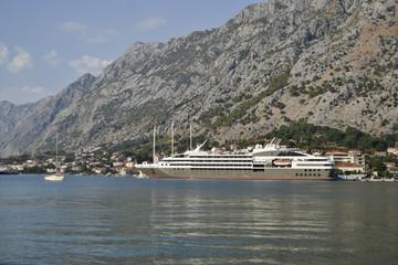 Beautiful view over Kotor, Montenegro (ocean, boat, cruiser)