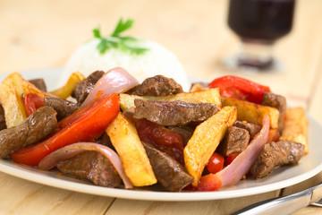Peruvian dish Lomo Saltado (beef, tomato, red onion, French fries)