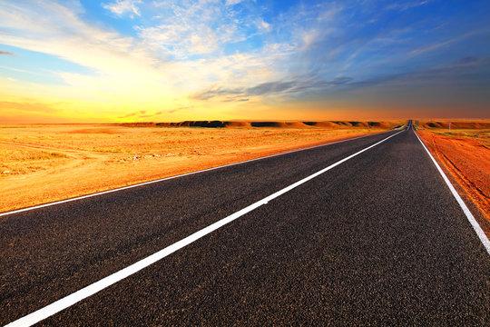Open road.Dramatic sunset sky in the desert.