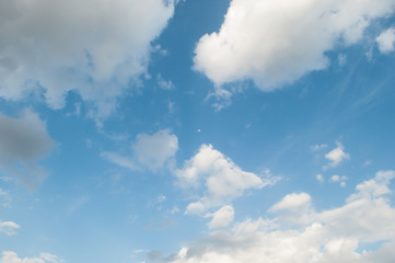 Sky with clouds and little moon