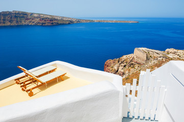 Sunbeds on the terrace of a hotel. Santorini island, Greece.