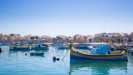 Traditional fishing boats at Marsaxlokk market, Malta
