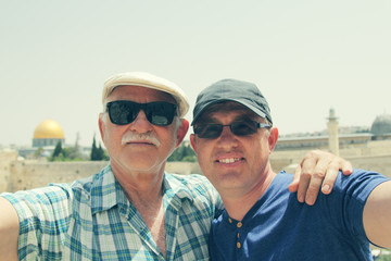 Selfie portrait of father and adult son
