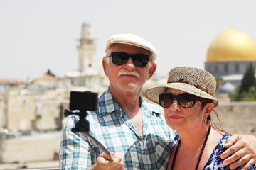 Happy loving senior couple enjoying vacation together