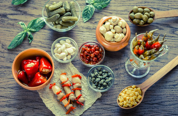 Pickled vegetables on the wooden background