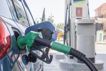 Refueling gasoline in a car