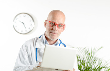 a doctor with laptop in his office