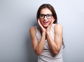 Excited surprising fun young woman with open mouth in glasses