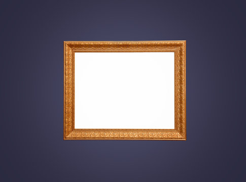 Empty gold frame on blue wall