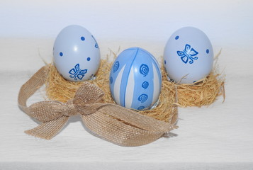 Easter eggs,straw and bow-knot