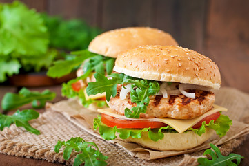 Fototapeta Sandwich with chicken burger, tomatoes, cheese and lettuce obraz