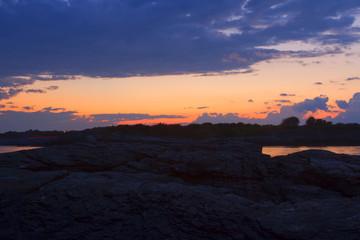 Sunset on a rocky shore.