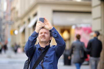 Man taking photo using his smart phone