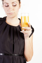 Portrait of beautiful woman with a glass of juice