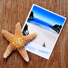 starfish and an instant photo of a beach with the text happy sum