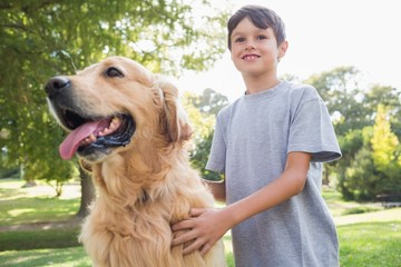 Little boy with his dog in the park