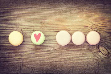 Different colors and  flavors French Macarons on  old wooden bac