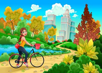 Lady on a bike in a urban park