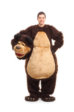 Full length portrait of a young man in bear costume