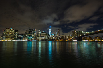 New York by night: Lower Manhattan and the Brooklyn Bridge as seen from Brooklyn side, in the center of the picture the One World Trade Center (Freedom Tower)