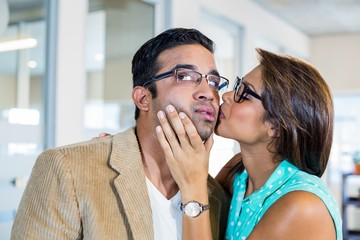 Beautiful brunette kissing her boyfriend