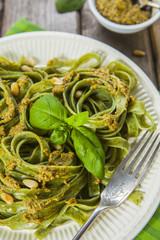 Homemade spinach pasta with pesto