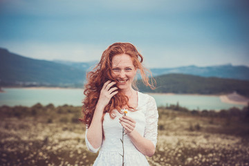 Beautiful woman enjoying field, harmony concept