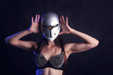 Sexy female go go dancer with mask