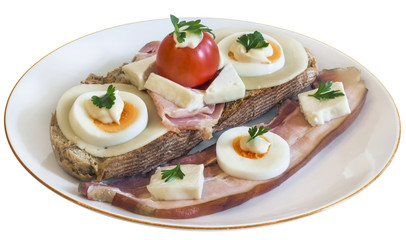 Toast Sandwich on porcelain plate, with Ham, Cheese, Egg slices, Cherry Tomato, Mayonnaise, Parsley leaves, and an extra Pork Bacon Rasher alongside, isolated on White Background.