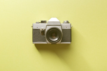 retro camera on colored background