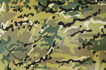 Multicam military camouflage fabric texture background