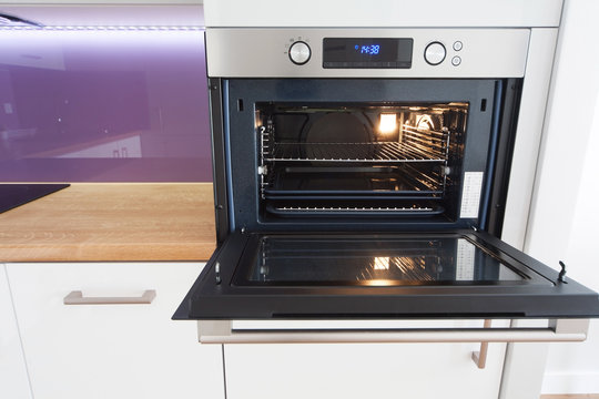 modern kitchen with open oven