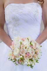 Brides wedding bouquet and wedding dress.